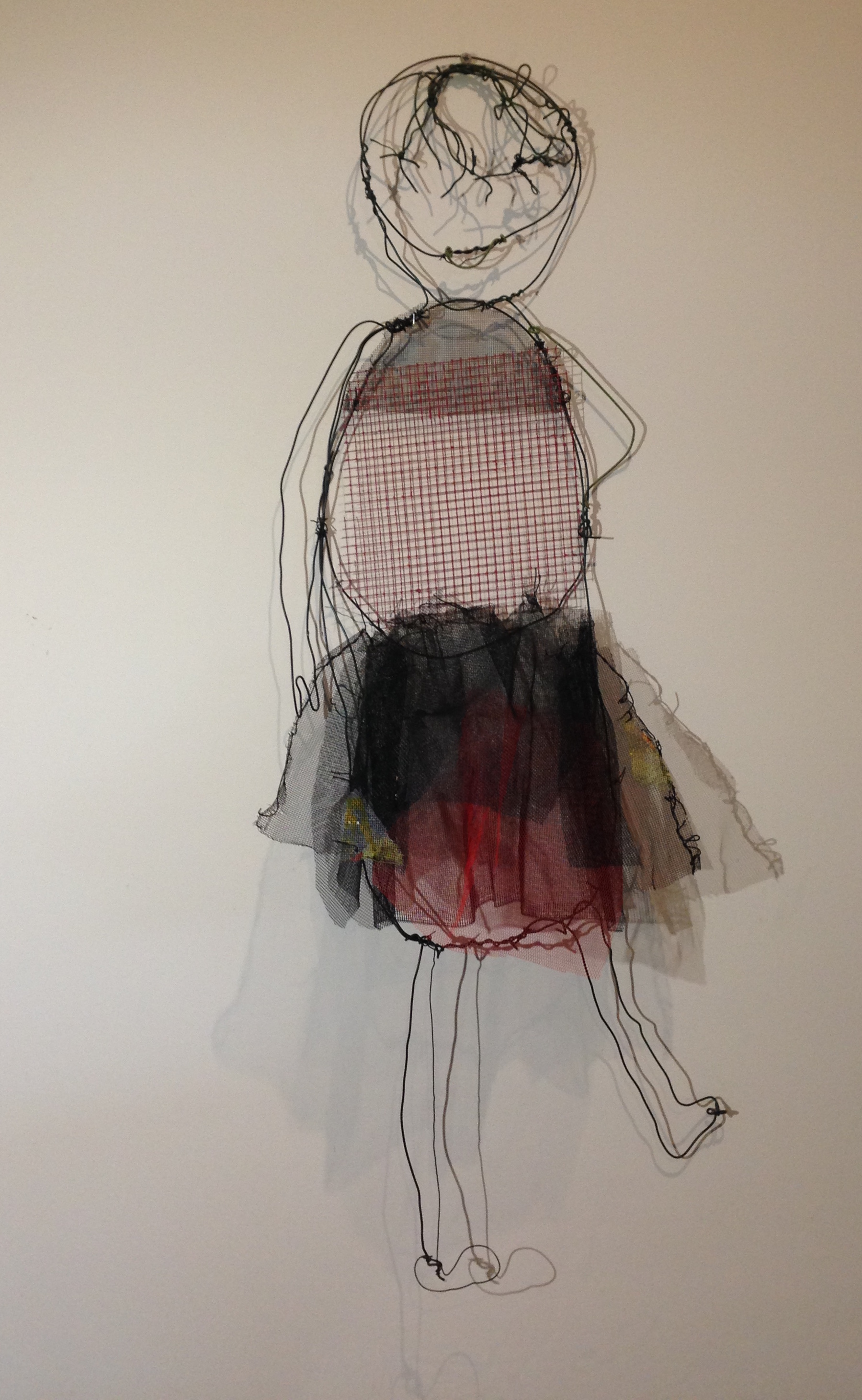 A girl in black and red tutu wire and naturally dyed textile, 70 x 30cm