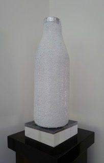 Milk Bottle, zinc nails, aluminium and enamel spray paint and pine, 47 x 18cm
